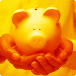 Two hands holding a piggy bank, orange color.